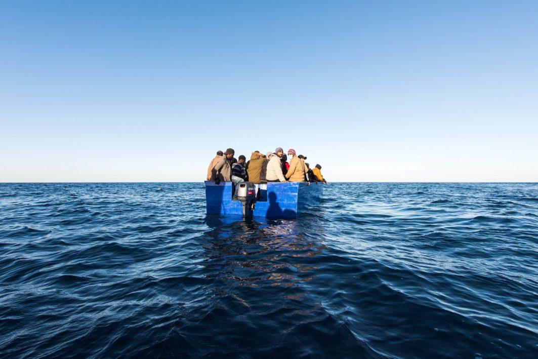 Flüchtlinge in einem Boot