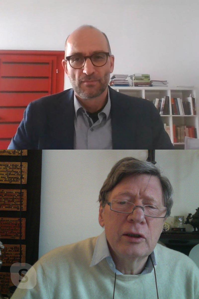 Das Bild zeigt zwei Männer bei einem Skype-Interview. In der unteren Hälfte ist ohannes von Dohnanyi zu sehen und in der oberen Hälfte Jürgen Bast.